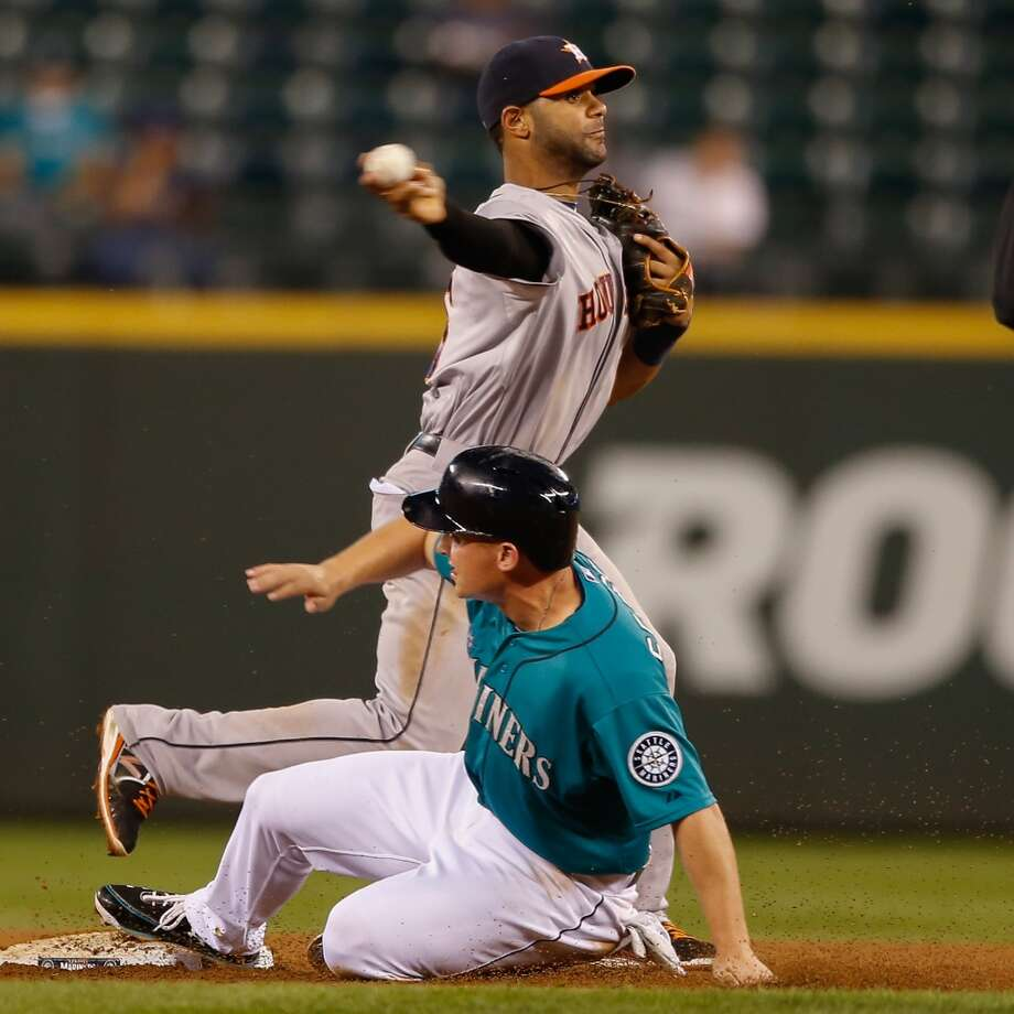 Jonathan Villar of the Astros turns a double play over Kyle Seager of the Mariners. Photo: Otto Greule Jr, Getty Images