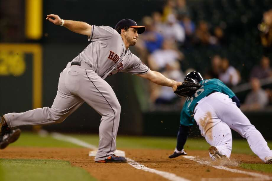 Brett Wallace of the Astros tags out Abraham Almonte of the Mariners. Photo: Otto Greule Jr, Getty Images