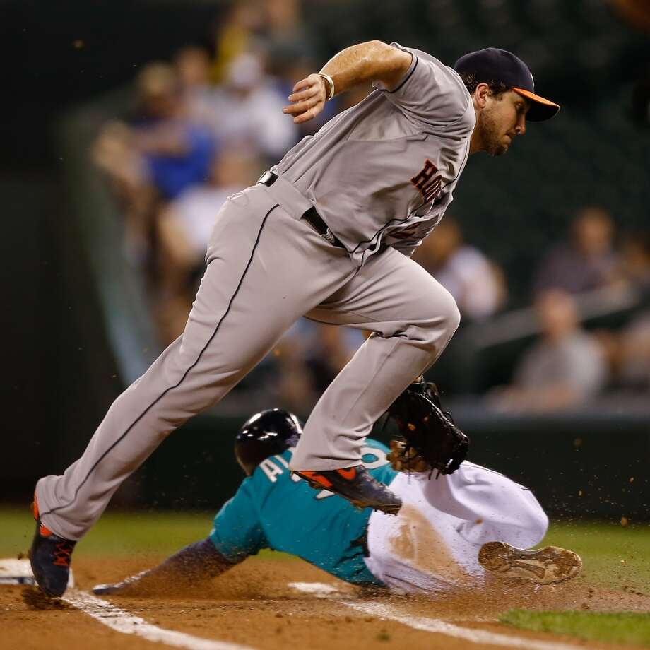 Brett Wallaceof the Astros tags out Abraham Almonte of the Mariners attempting to bunt for a base hit in the third inning. Photo: Otto Greule Jr, Getty Images
