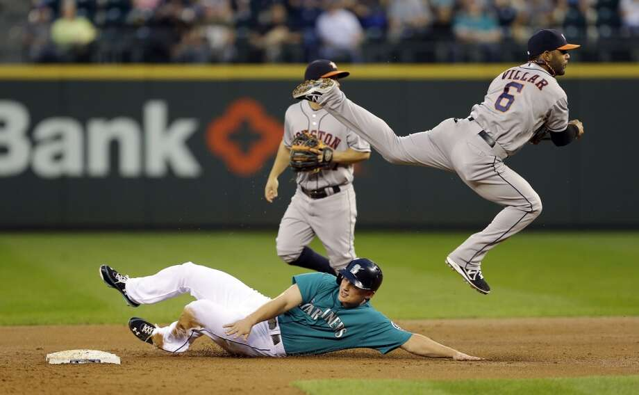 Astros  shortstop Jonathan Villar leaps over Kyle Seager of the Mariners. Photo: Ted S. Warren, Associated Press