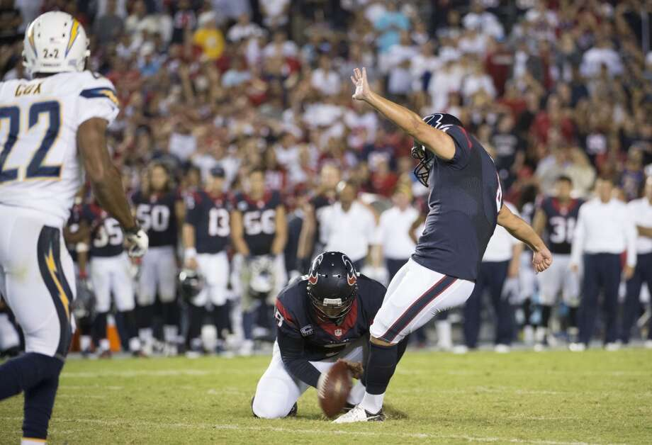Texans kicker Randy Bullock kicks the game-winning 41-yard field goal as punter Shane Lechler holds. Photo: Smiley N. Pool, Houston Chronicle