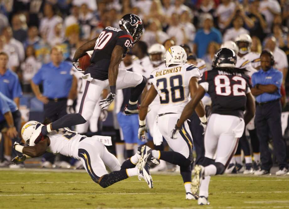 Texans wide receiver Andre Johnson hurdles Chargers defensive back Richard Marshall. Photo: Brett Coomer, Houston Chronicle