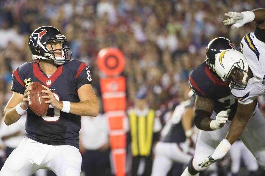 Texans quarterback Matt Schaub gets off a pass as Chargers defensive end Corey Liuget applies pressure. Photo: Smiley N. Pool, Houston Chronicle