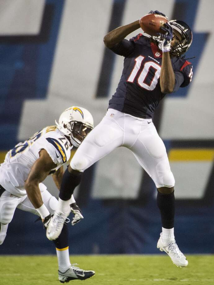 Texans wide receiver DeAndre Hopkins makes a catch as Chargers defensive back Johnny Patrick defends. Photo: Smiley N. Pool, Houston Chronicle
