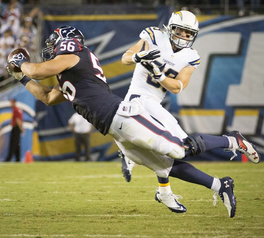 Texans inside linebacker Brian Cushing intercepts a pass intended for Chargers running back Danny Woodhead. Photo: Smiley N. Pool, Houston Chronicle