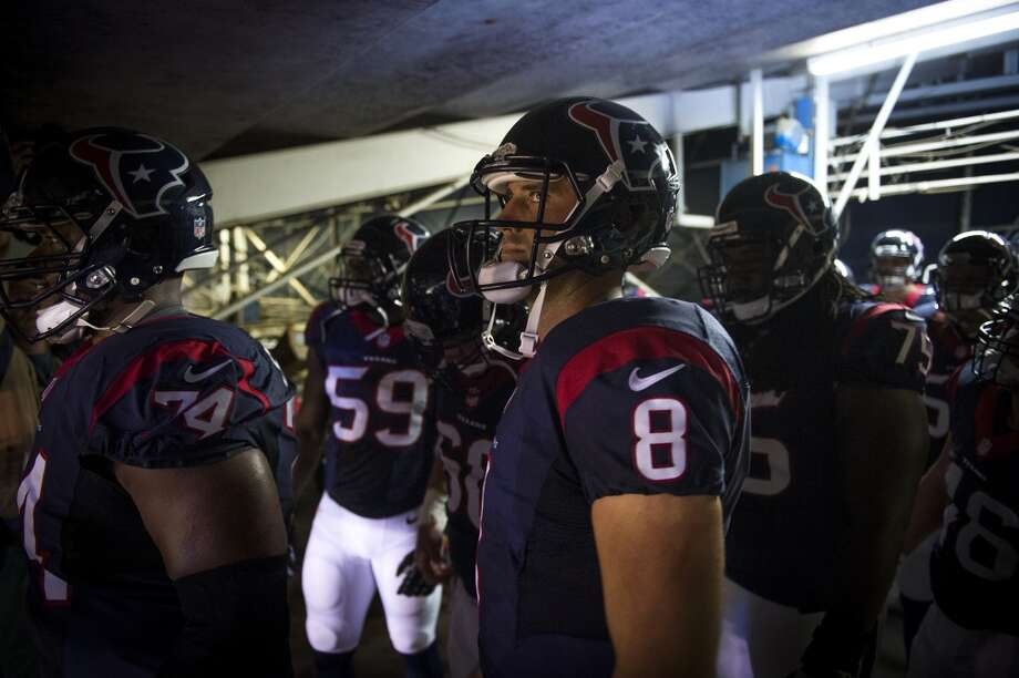 Texans quarterback Matt Schaub waits in the tunnel to take the field for the season-opener against the Chargers. Photo: Smiley N. Pool, Houston Chronicle