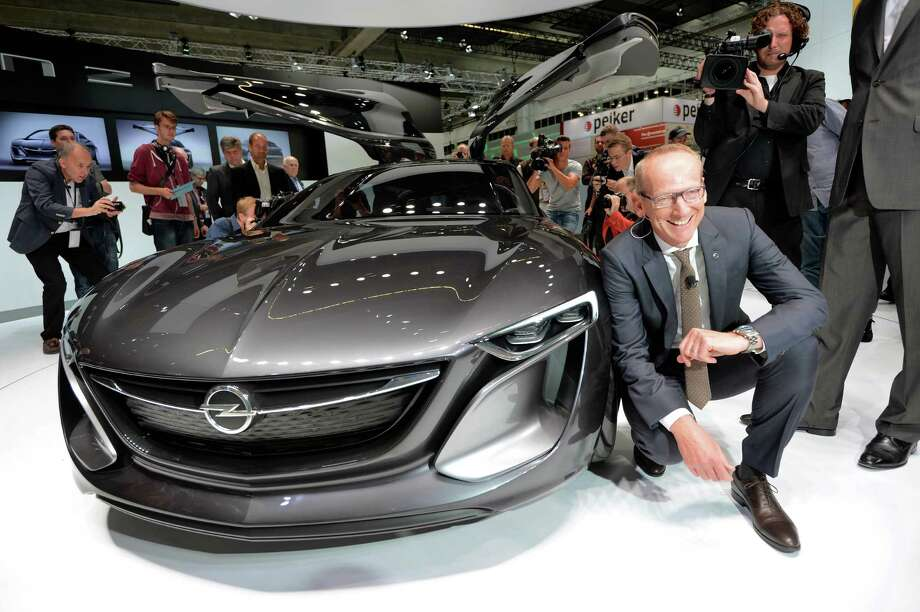 Chairman of the board of Opel Karl-Thomas Neumann presents the new 'Monza' concept  at the IAA international automobile show in Frankfurt, Germany. The world's biggest motor show, the IAA, is running from September 12 to 22, 2013.  More than 1.000 exhibitors from 35 countries will present their products during the show. Photo: Thomas Lohnes, Getty Images / 2013 Getty Images