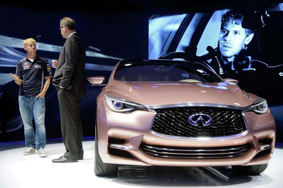 Formula One World Champion Sebastian Vettel (L) and the president of Infiniti Motor Company LTD Johann de Nysschen (R) present the new Q30 concept at the IAA International Automobile Exhibition in Frankfurt, Germany. The world's biggest motor show, the IAA, is running from September 12 to 22, 2013.  More than 1.000 exhibitors from 35 countries will present their products during the show. Photo: Thomas Lohnes, Getty Images / 2013 Getty Images