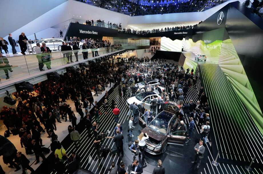 Visitors look at Mercedes cars at the at the IAA international automobile show in Frankfurt, Germany. The 2013 IAA will be open to the public from September 12-22. Photo: Thomas Lohnes, Getty Images / 2013 Getty Images