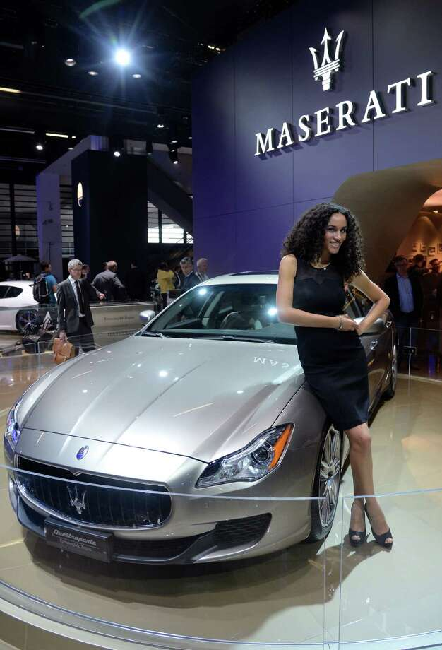 A model stands beside the Maserati Quattroporte Ermenegildo Zegna at the IAA International Automobile Exhibition in Frankfurt, Germany. The world's biggest motor show, the IAA, is running from September 12 to 22, 2013.  More than 1.000 exhibitors from 35 countries will present their products during the show. Photo: Thomas Lohnes, Getty Images / 2013 Getty Images