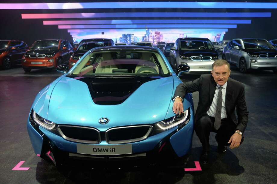Chairman of the board of BMW Norbert Reithofer presents the new BMW i8 hybrid supercar at the IAA international automobile show in Frankfurt, Germany. The world's largest motor show, the IAA, is held biennially and will run from September 12 to 22, 2013.  More than 1.000 exhibitors from 35 countries will present their products during the show. Photo: Thomas Lohnes, Getty Images / 2013 Getty Images