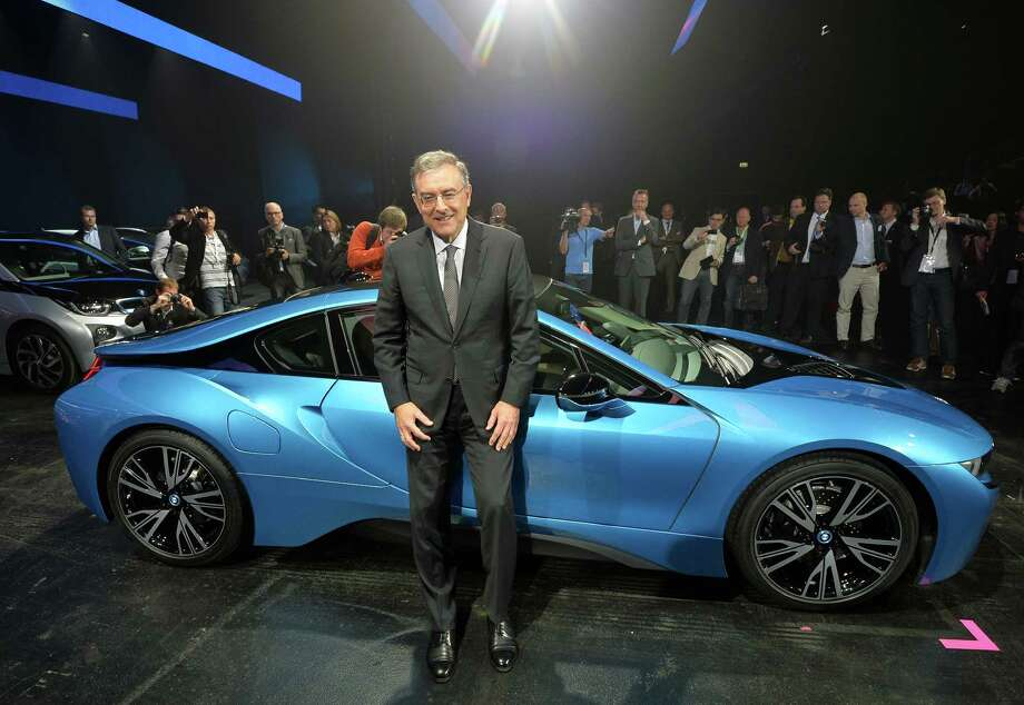 Chairman of the board of BMW Norbert Reithofer presents the new BMW i8 hybrid supercar at the IAA international automobile show in Frankfurt. The world's largest motor show, the IAA, is held biennially and will run from September 12 to 22, 2013.  More than 1.000 exhibitors from 35 countries will present their products during the show. Photo: Thomas Lohnes, Getty Images / 2013 Getty Images