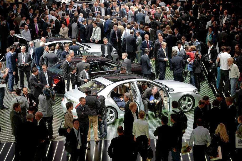 Visitors look at Mercedes cars at the at the IAA International Automobile Exhibition in Frankfurt, Germany. The 2013 IAA will be open to the public from September 12-22. Photo: Thomas Lohnes, Getty Images / 2013 Getty Images