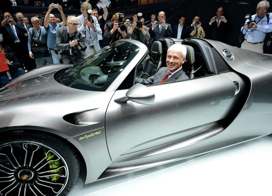 Chairman of the board of Porsche AG Matthias Mueller presents the new Porsche 918 Spyder during the press day at the international motor show IAA (Internationale Automobil-Ausstellung) in Frankfurt. The world's biggest motor show, the IAA, is running from September 12 to 22, 2013. Photo: Thorsten Wagner, Bongarts/Getty Images / 2013 Thorsten Wagner