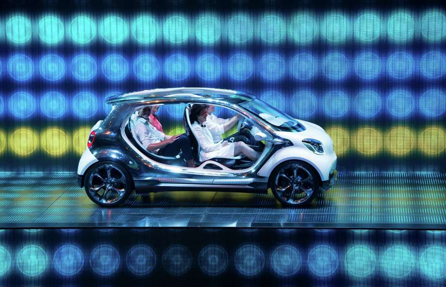 The new Smart four joy is presented at the booth of Mercedes during the IAA (Internationale Automobil Ausstellung) international automobile show in Frankfurt. According to the organizer, more than 1,000 exhibitors from 35 countries will present their products during the show running from September 12 to 22, 2013. Photo: JOHANNES EISELE, AFP/Getty Images / 2013 AFP