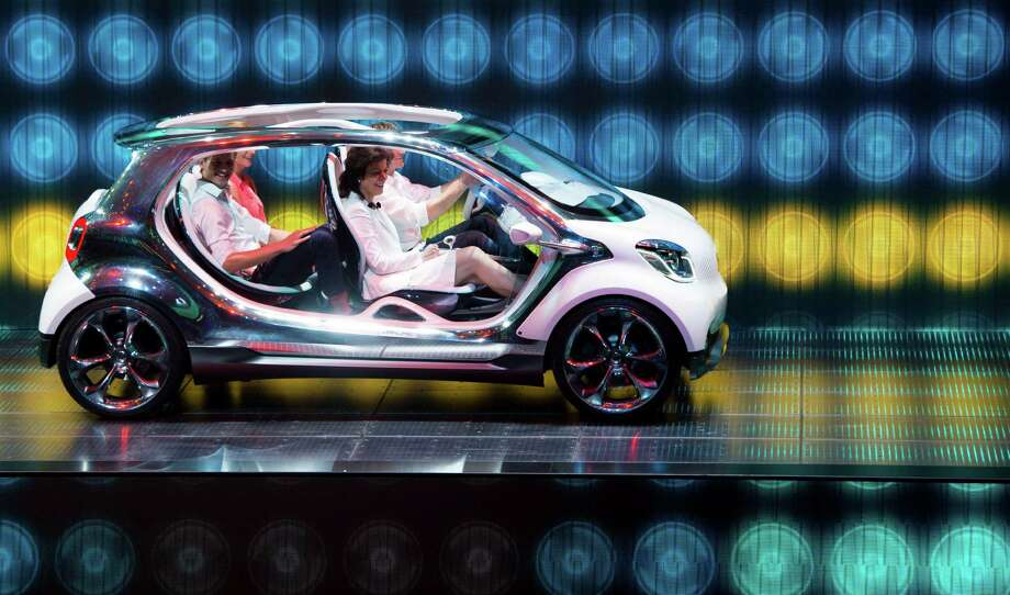 The new Smart four joy is presented at the Mercedes booth during the IAA (Internationale Automobil Ausstellung) international automobile show in Frankfurt. According to the organizer, more than 1,000 exhibitors from 35 countries will present their products during the show running from September 12 to 22, 2013. Photo: JOHANNES EISELE, AFP/Getty Images / 2013 AFP