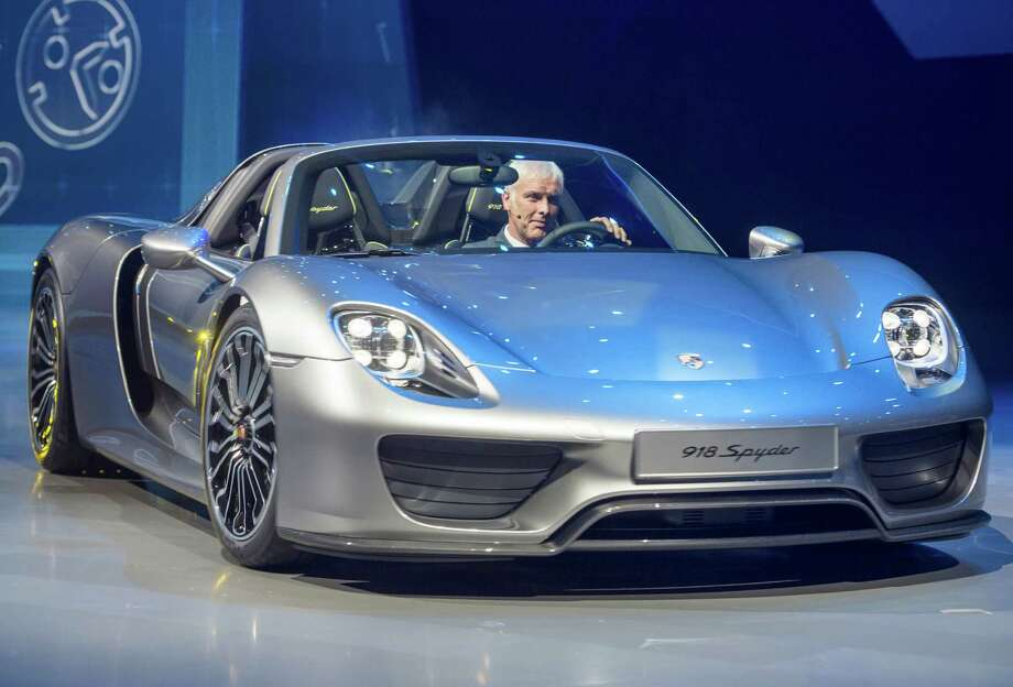 Chairman of the board of Porsche Matthias Mueller presents the new Porsche 918 Spyder during the Group night at the international motor show IAA (Internationale Automobil-Ausstellung) in Frankfurt. The world's largest motor show, the IAA runs September 12-22. More than 1.000 exhibitors from 35 countries will present their products at IAA. Photo: Thomas Lohnes, Getty Images / 2013 Thomas Lohnes