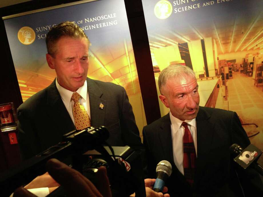 Lt. Gov. Robert Duffy and CNSE?s Senior Vice President and CEO Alain Kaloyeros answer questions at the news conference Monday announcing the new use for Kiernan Plaza. ( Casey Seiler / Times Union )