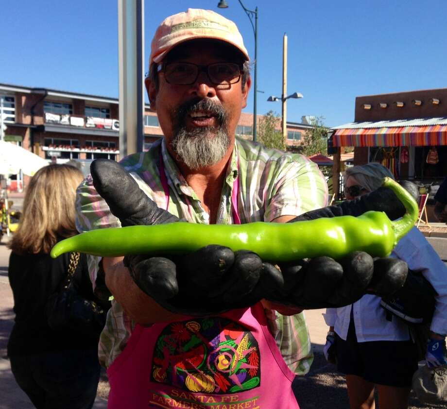 Matt Romero with a foot-long chile at the Santa Fe Farmers Market