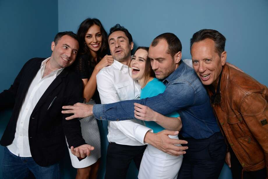 (L-R) Director Richard Shepard, actress Madalina Ghenea, actor Demian Bichir, actress Emilia Clarke, actor Jude Law and actor Richard E. Grant of 'Don Hemingway' pose at the Guess Portrait Studio during 2013 Toronto International Film Festival on September 9, 2013 in Toronto, Canada. Photo: Larry Busacca, Getty Images