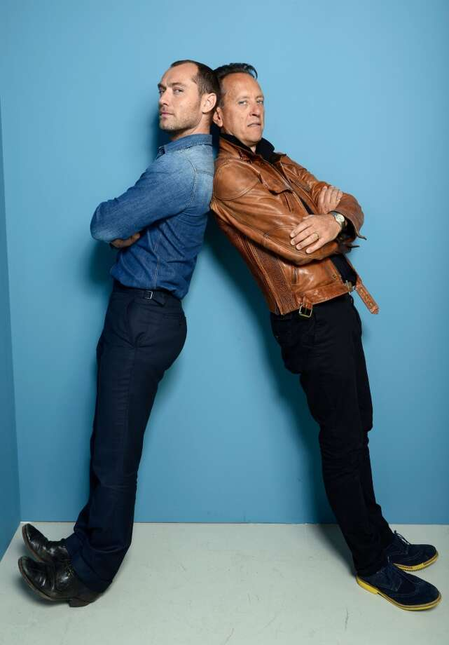 Actors Jude Law and Richard E. Grant of 'Don Hemingway' pose at the Guess Portrait Studio during 2013 Toronto International Film Festival on September 9, 2013 in Toronto, Canada. Photo: Larry Busacca, Getty Images