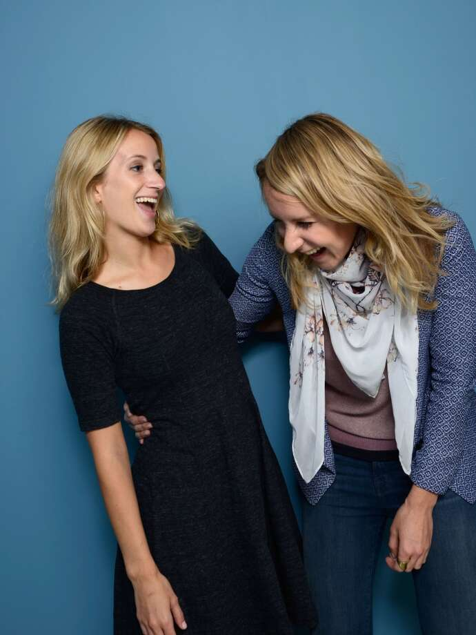 Prodcuer Grace Hughes-Hallett and director Sarah McCarthy of 'The Dark Matter Of Love' pose at the Guess Portrait Studio during 2013 Toronto International Film Festival on September 8, 2013 in Toronto, Canada. Photo: Larry Busacca, Getty Images