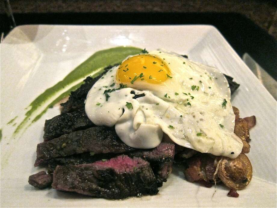 Wagyu skirt steak with duck-fat potatoes, chimichurri and a fried egg at Vic & Anthony's Steakhouse. Photo: Alison Cook