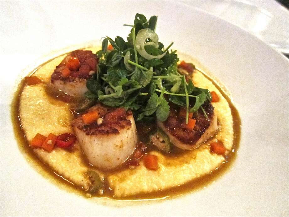 Seared scallops with smoked polenta, pickled okra and sauce piquant at Reef. Photo: Alison Cook