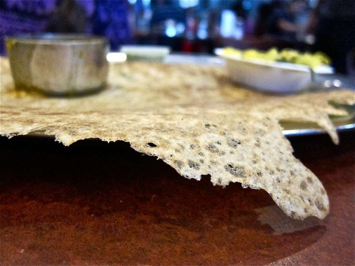 The rava dosa (semolina) crepe's textbook lacy edge at Shri Balaji Bhavan.