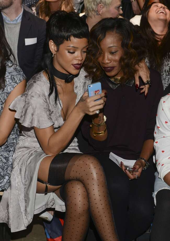 Rihanna and Melissa Forde attend the Opening Ceremony fashion show during Mercedes-Benz Fashion Week Spring 2014 at SuperPier 25 on September 8, 2013 in New York City. Photo: Vivien Killilea, Getty Images