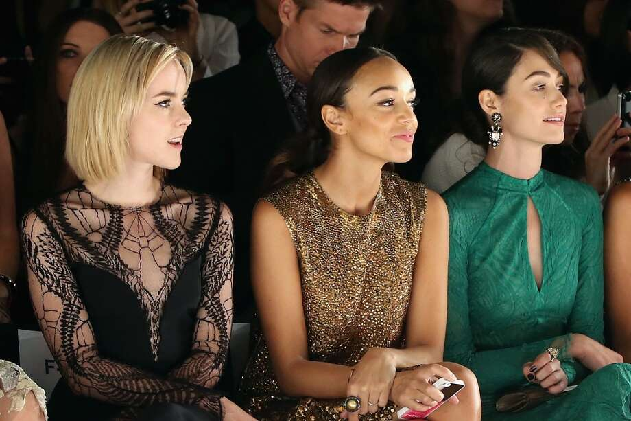 (L-R) Jena Malone, Ashley Madekwe, and Emmy Rossum attend the Monique Lhuillier fashion show during Mercedes-Benz Fashion Week Spring 2014 at The Theatre at Lincoln Center on September 7, 2013 in New York City. Photo: Neilson Barnard, Getty Images For Mercedes-Benz Fashion Week Spring 2014