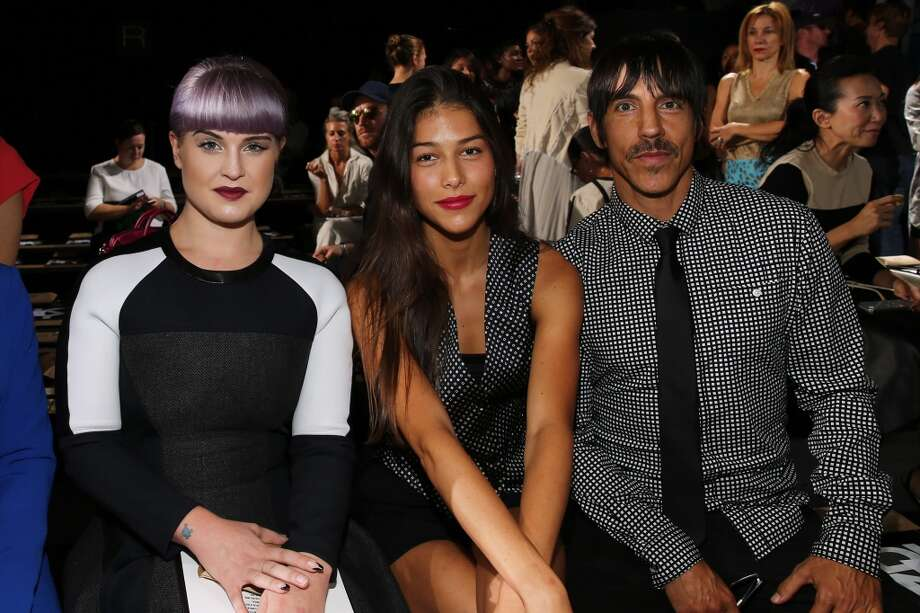 (L-R) Kelly Osbourne, Helena Vestergaard and Anthony Kiedis attend DKNY Women's fashion show during Mercedes-Benz Fashion Week Spring 2014 on September 8, 2013 in New York City. Photo: Neilson Barnard, Getty Images