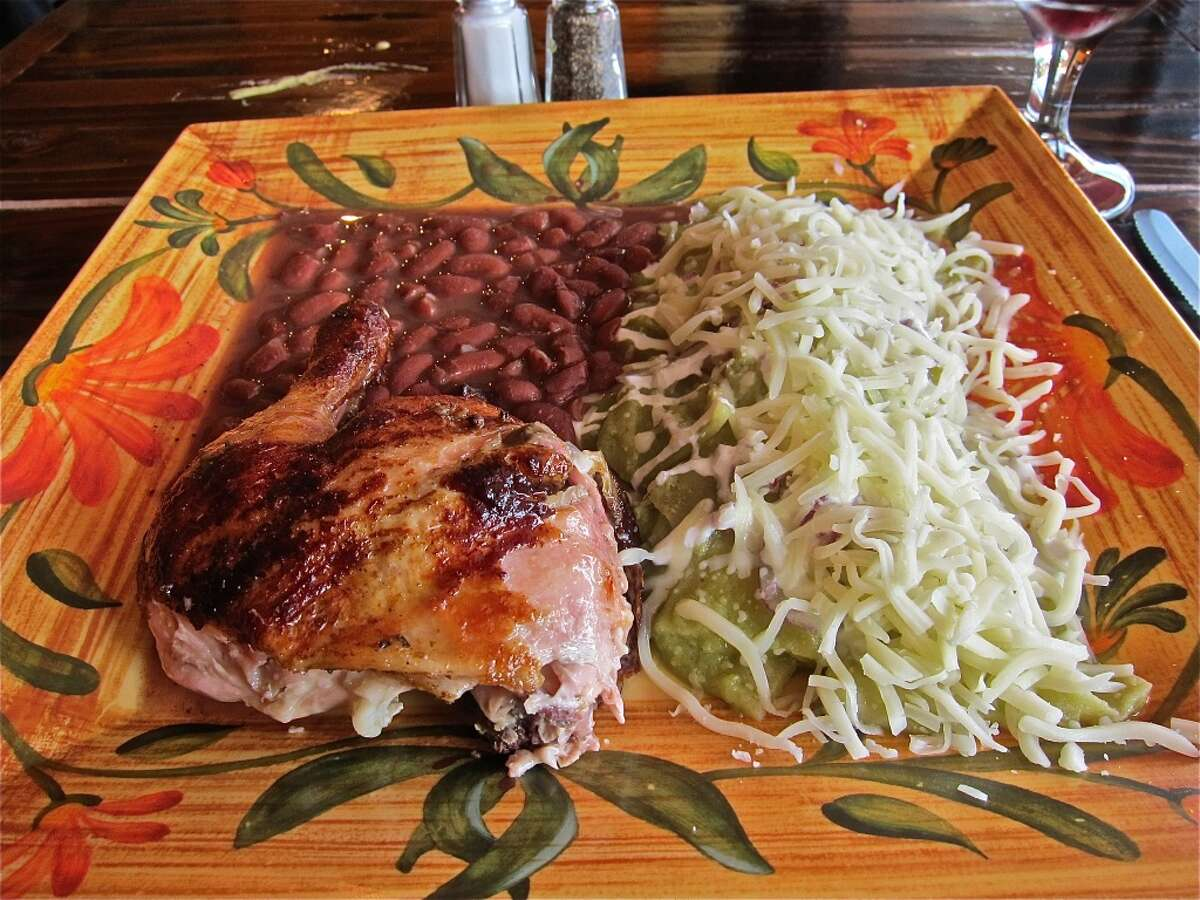 Chilaquiles verdes plate with chicken and beans at Pollo Bravo.