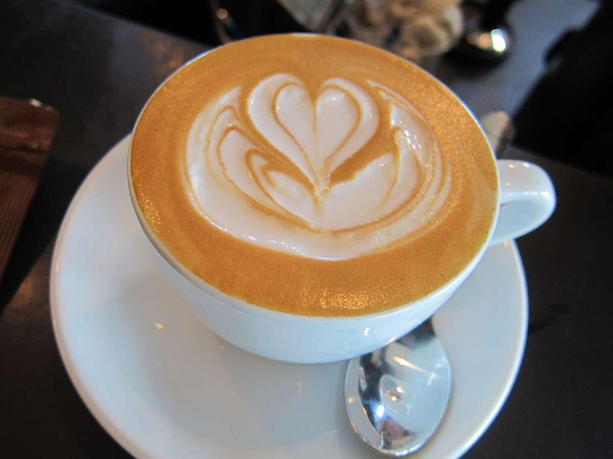 Flat White coffee drink at Blacksmith Coffee