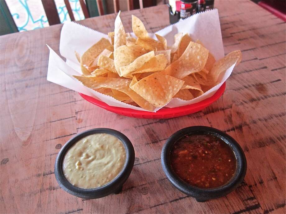 PHOTOS: The best places to celebrate National Tortilla Chip Day in HoustonThe iconic Laurenzo family tortillas chips with red and green table salsas on display at the El Tiempo on Navigation. They didn't last long on the table. Click through to see where to get your fix in Houston according to Houston Chronicle food experts Alison Cook, Syd Kearney, Greg Morago and Jody Schmal....  Photo: Alison Cook