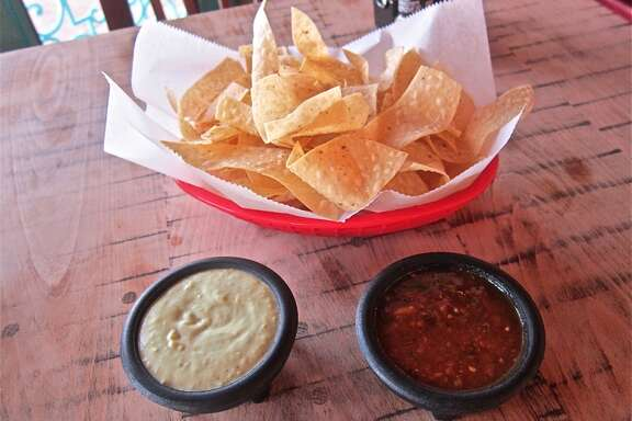 The iconic Laurenzo family tortillas chips with red and green table salsas at the new El Tiempo on Navigation.