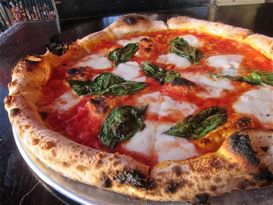 The classic Neapolitan Pizza Margherita with buffalo mozzarella at Dolce Vita. Photo: Alison Cook