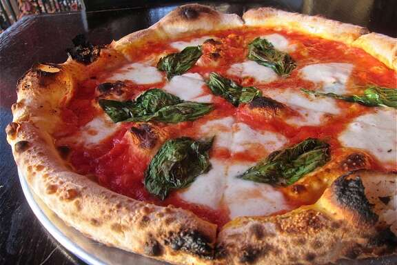 The classic Neapolitan Pizza Margherita with buffalo mozzarella at Dolce Vita.