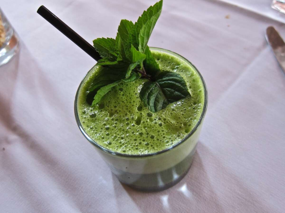 Kale juice with spinach, apple, mint, ginger and cilantro from the brunch menu at Indika.