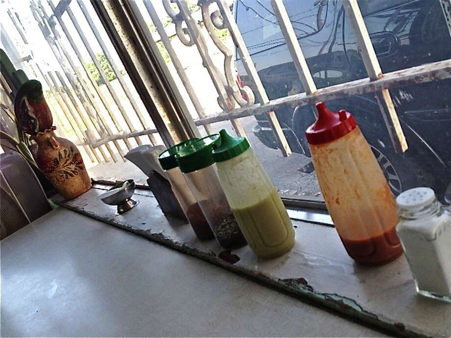 Condiment and salsa array on the counter windowsill at La Azteca. Photo: Alison Cook
