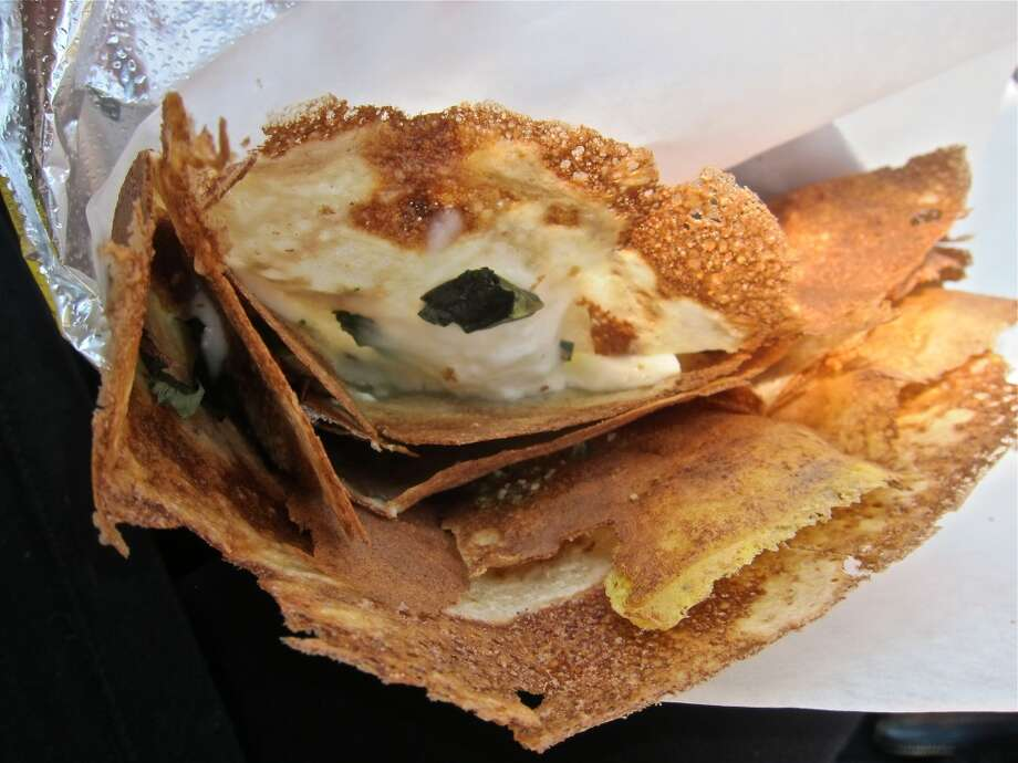 This is the mozzarella and basil crepe with egg and a pepita vinaigrette at the Melange Creperie cart. Photo: Alison Cook