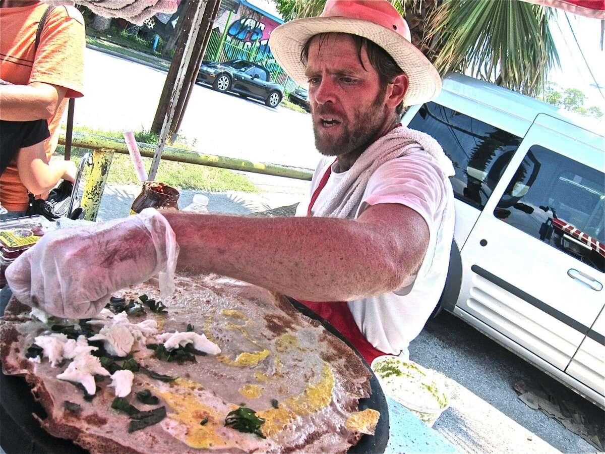 Sean Carroll makes an egg, mozzarella and basil crepe with pepita vinaigrette at Melange Creperie.