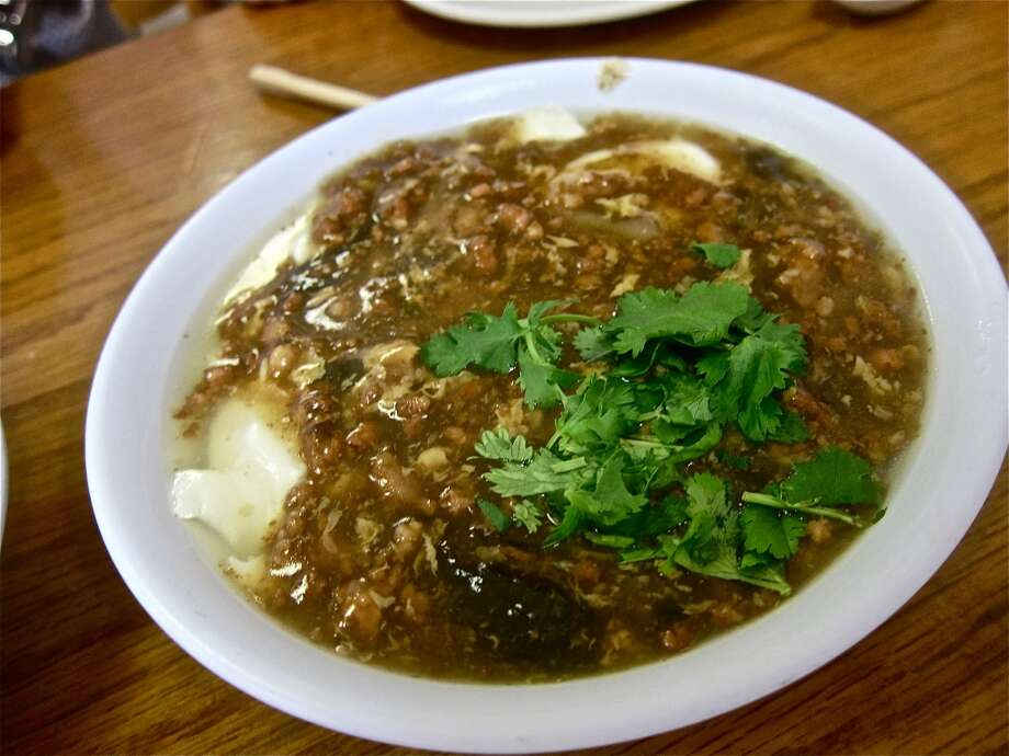 Classic KitchenCuisine: ChineseDish: salted Jellied Tofu with ground pork, glassy tree ear fungus and cilantro  Entree price range: $ Where: 9888 Bellaire, Suite 108Phone: 713-270-8545 Photo: Alison Cook