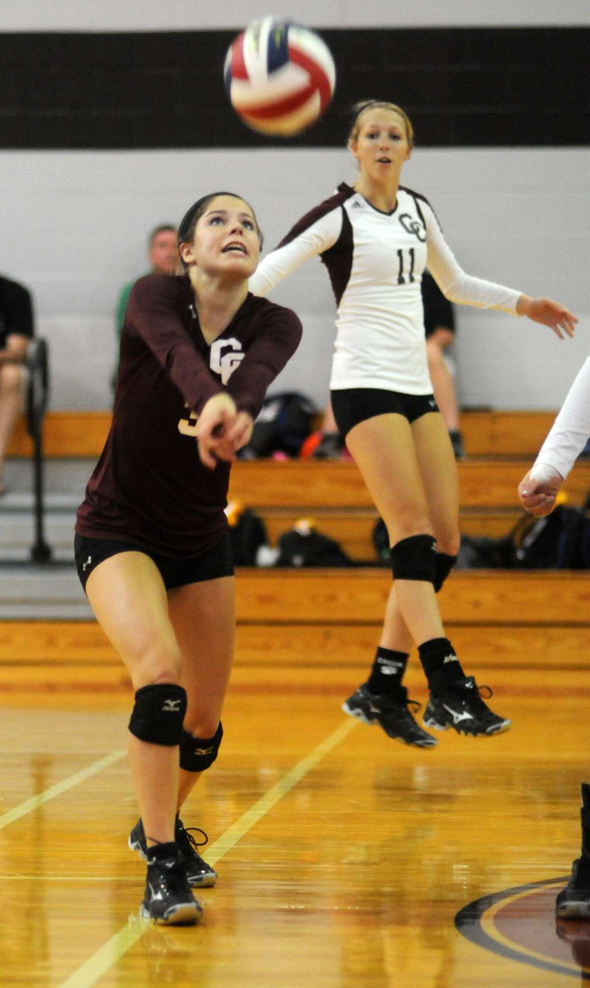 Clear Creek senior defensive specialist Madison Wadyka makes a play against New Caney during a pool play match at the 2013 Texas Volleyball Invitational in Pearland. Freelance photo by Jerry Baker