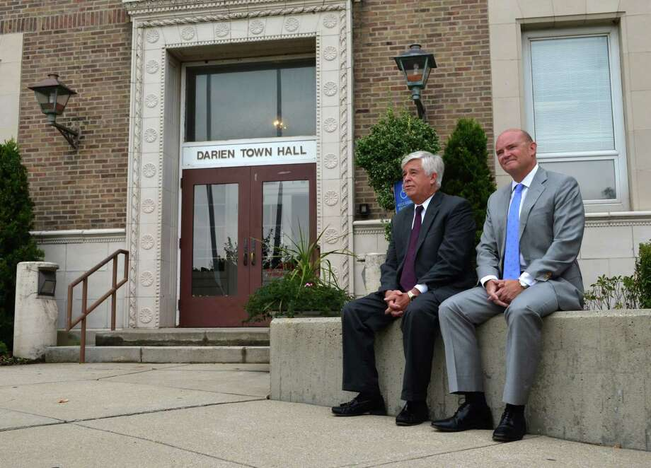 Democratic selectmen candidates Kip Hall, at left, and Reilly Tierney met with members of the press outside Town Hall on Tuesday morning to discuss their platforms. The over-reaching message was that they were going to be diligent with the budget to keep mill rate increases low. The Democratic Town Committee did not put forward a candidate to challenge Republican incumbent Jayme Stevenson for first selectman. Hall and Tierney were also joined by Frank Huck for Board of Finance and Tom Valentino for Town Treasurer, who are not pictured. Photo: Megan Spicer