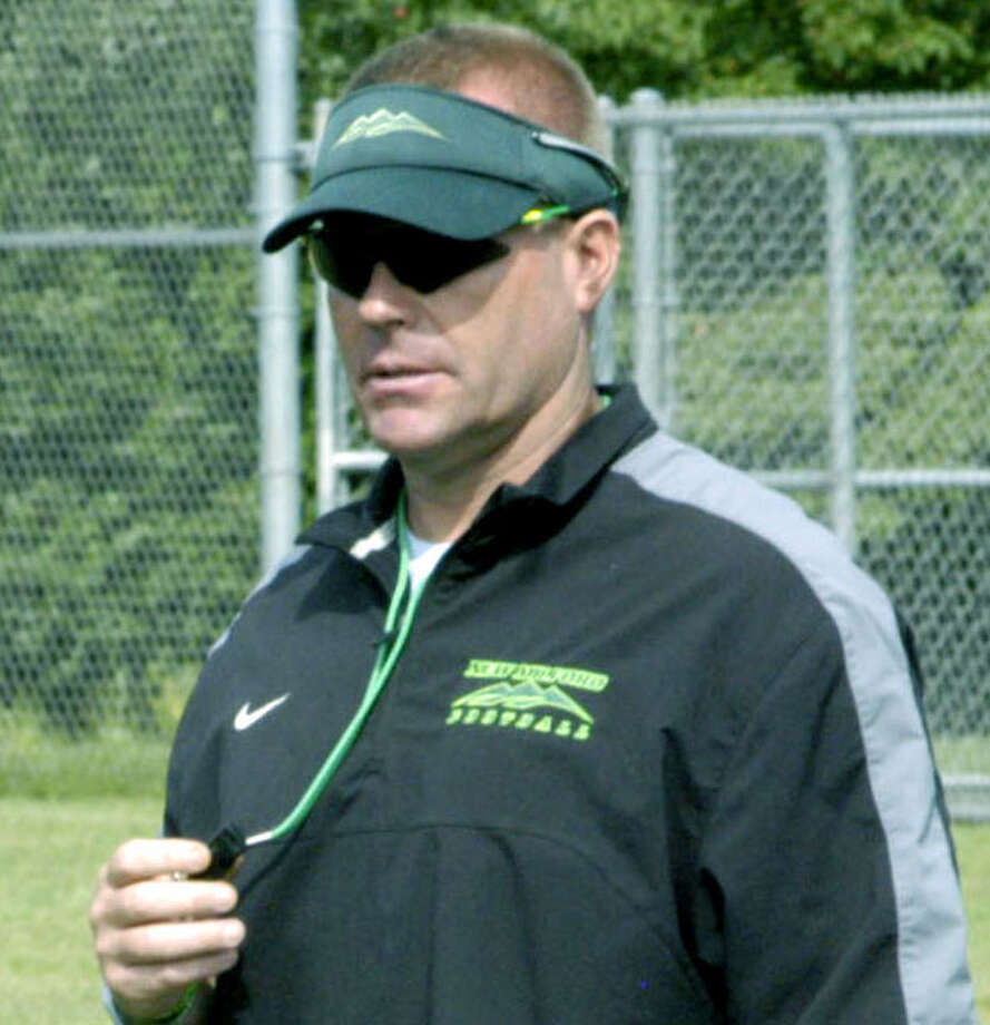New Milford High School football coach John Murphy surveys pre-season practice in days leading up to the 2013 campaign, September 2013 Photo: Norm Cummings