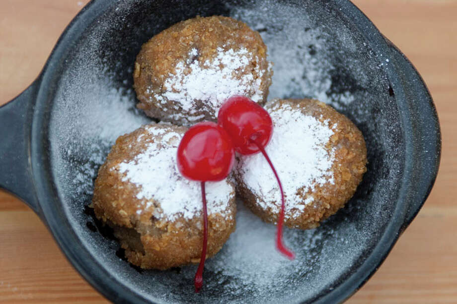 Deep-fried chocolate chip cookies dusted with powdered sugar called Lil' Nookies are photographed at Torchy's Tacos-River Oaks. Photo: J. Patric Schneider, For The Chronicle / Houston Chronicle