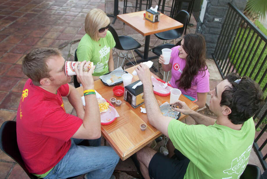 Justin Nelson, left, Matt Bertram, Margo Hanks  and Abby Hill enjoy a breakfast at Torchy's Tacos-River Oaks. Photo: J. Patric Schneider, For The Chronicle / Houston Chronicle