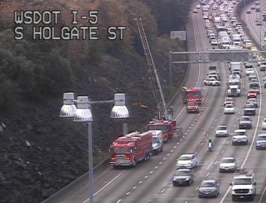 Rescue workers respond to a trapped man off of Interstate 5 in Seattle. Department of Transportation photo.