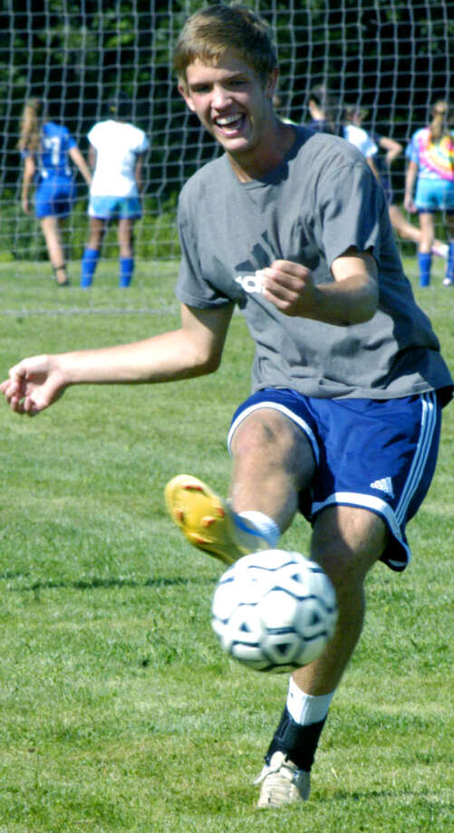 Logan Racz and his Spartan teammates get a kick out of a game of keepaway during pre-season practice for Shepaug Valley High School boys' soccer, September 2013 Photo: Norm Cummings